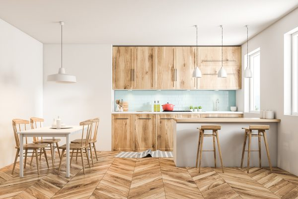 White Scandinavian style kitchen interior with blue tiled and white walls, a wooden floor, wooden countertops and cabinets and a table with chairs. 3d rendering mock up